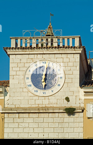 city hall with clock tower at the market place in the old town of Cres in Croatia - Stock Photo