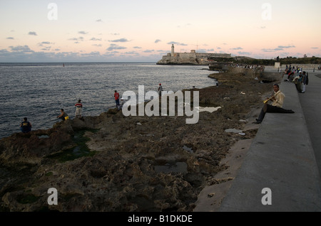 People on rest on the Malecón, Havana - Stock Photo
