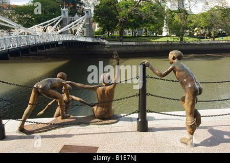 First Generation, a Sculpture of Five Boys Leaping into the Singapore River near Cavenagh Bridge in Singapore - Stock Photo