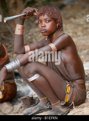 Hamar women dance at a 'Jumping of the Bull' ceremony. The Hamar are semi-nomadic pastoralists of Southwest Ethiopia. - Stock Photo