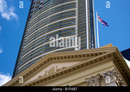 Old Customs House with modern office and apartment building behind Brisbane Queensland Australia - Stock Photo