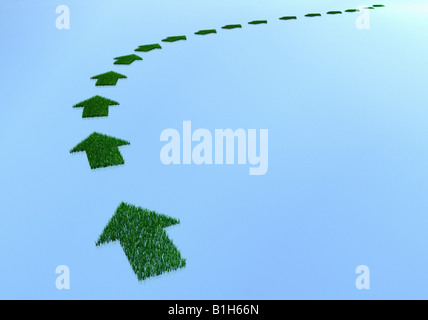 Grass covered direction arrows - Stock Photo