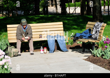 Homeless Woman And A Man Reading A Book In The Rain Are Separated By Stock Photo Royalty Free