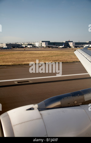 Aerial view north with commercial aircraft of Heathrow Airport buildings London TW6 England - Stock Photo