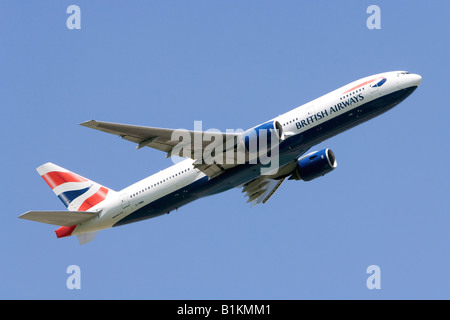 Boeing 777 operated by British Airways climbing out from London Heathrow Airport - Stock Photo