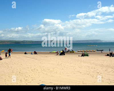 A view of the beach with the Purbeck peninsula in the background,at Weymouth,Dorset,UK. - Stock Photo