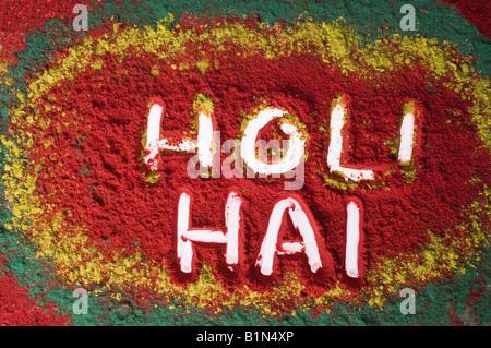 High angle view of text HOLI HAI written on a rangoli - Stock Photo