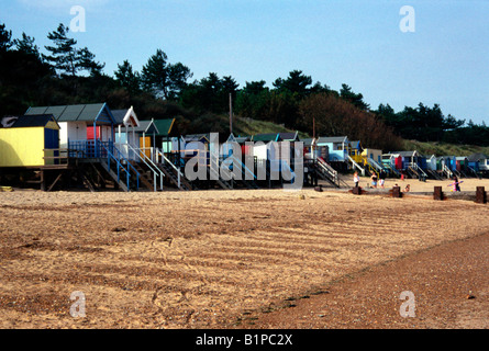 Row of beach huts along the beach at Wells Next the Sea, Norfolk, UK - Stock Photo