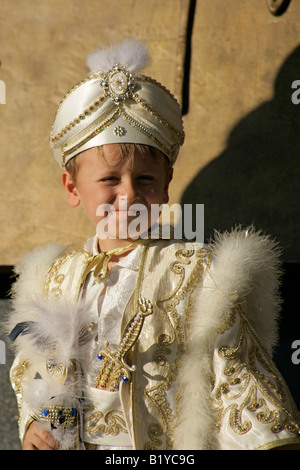 Young Turkish boy in his celebratory circumcision outfit, Turkey - Stock Photo