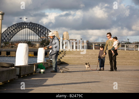 Father and Sons walking the Dog Pyrmont Point Park Sydney New South Wales Australia - Stock Photo