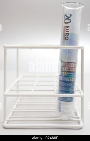 Euro currency in a test tube - Stock Photo