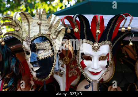 elaborate carnival masks make beautiful souvenirs on the Venetian island of Burano - Stock Photo