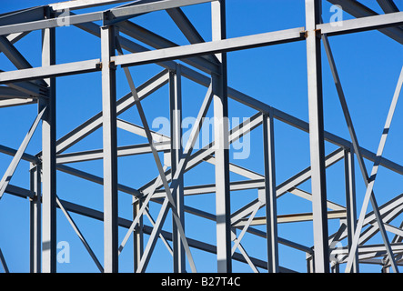 Beams at construction site under blue sky - Stock Photo