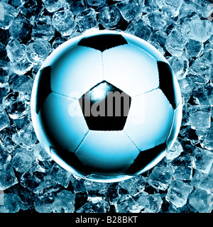 A Football photographed on top of ice cubes. Picture by Patrick Steel patricksteel - Stock Photo