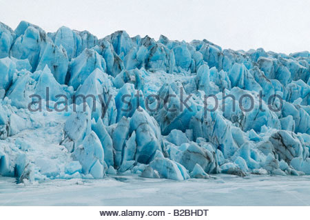 Ice cliffs along water - Stock Photo