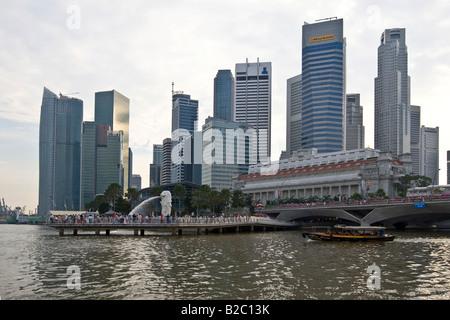 Financial District of Singapore at Marina Bay, Merlion, Singapore's landmark, half lion, half fish, Singapore, Singapore - Stock Photo