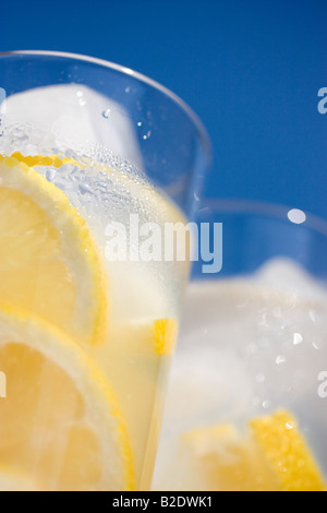 Glasses of lemonade in sunshine - Stock Photo