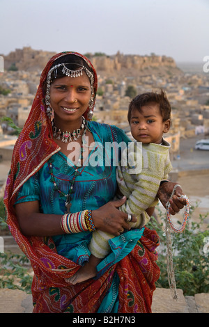 A BANJARI TRIBAL WOMAN and her son with traditional silver jewelry in the GOLDEN CITY of JAISALMER RAJASTHAN INDIA - Stock Photo