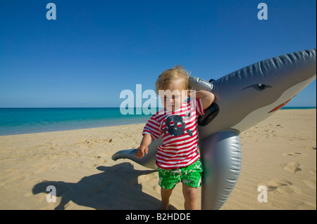 little boy with inflatable on beach - Stock Photo