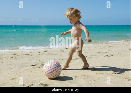 little boy playing with ball on beach - Stock Photo