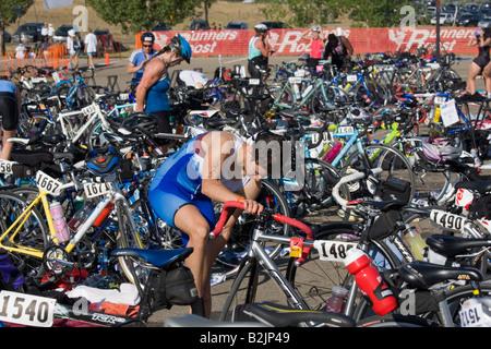 Molly Gutilla preparing for the bike race at the Boulder Peak Triathlon - Stock Photo