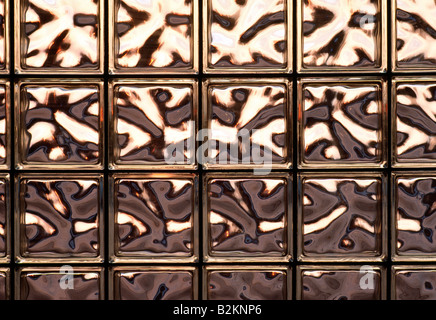 Abstract close up view of backlit glass block wall - Stock Photo