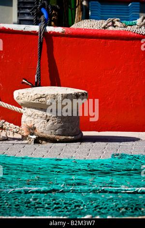 Ropes and fishing nets dry on a quay in Cala Ratjada, Majorca, Spain - Stock Photo