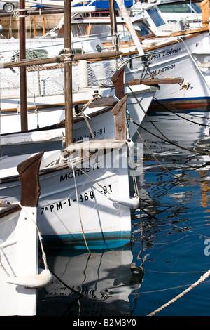 Yachts moored at pier in Cala Ratjada, Majorca, Spain - Stock Photo