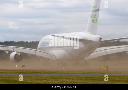 Airbus A380-800 Taking off kicking up a dust storm Farnborough Air Show 2008 - Stock Photo