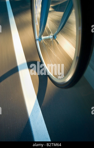 Bike Bicycle Tire Fast Motion Blur On Road Street Detail - Stock Photo
