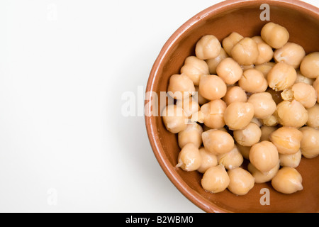 Chick peas in a dish - Stock Photo