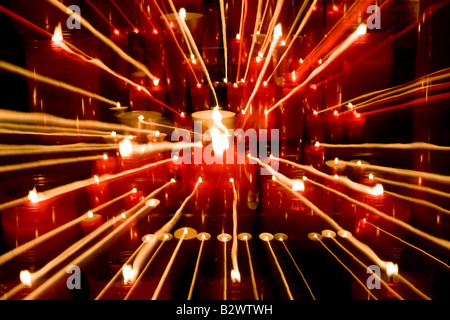 Candle Flames Abstract taken with slow shutter speed in a cathedral - Stock Photo