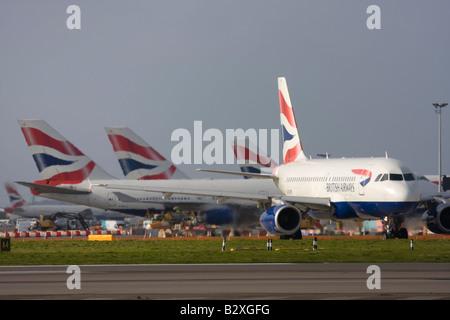 British Airways fleet at London Heathrow Airport - Stock Photo