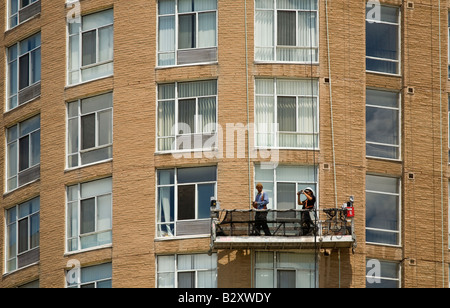 Two window cleaners working on a high-rise in Toronto, Ontario, Canada. - Stock Photo