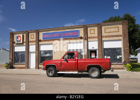 Old Time Pickup Truck With Red Cabin And Barrels In The