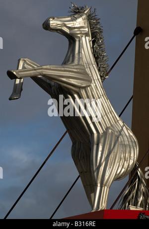 Iron horse sculpture above a metalworking business in suburban Melbourne, Australia - Stock Photo