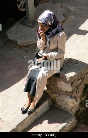 Young muslim turkish girl on her mobile phone, Istanbul, Turkey - Stock Photo