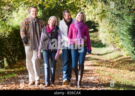 http://n450v.alamy.com/450v/b36cak/two-couples-walking-outdoors-in-park-and-smiling-b36cak.jpg