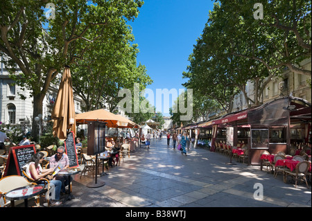 Street cafe in front of the Hotel de Ville, Place d l'Horloge, Avignon, Provence, France - Stock Photo