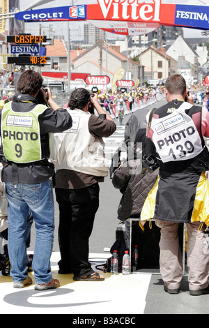 Press and Sports Photographers at the finish line of the time trial in Cholet, part of the 2008 Tour De France cycle - Stock Photo