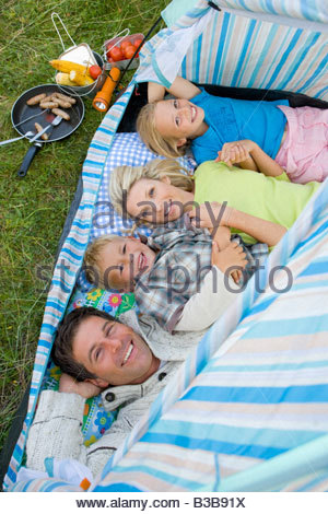 Young family lying in tent high angle view - Stockfoto