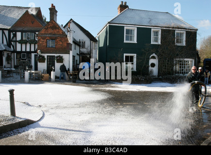 Creating a winter location set for 'The Holiday' film, in the village of Shere, Surrey, with artificial snow by - Stock Photo
