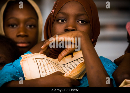 Girl holding sheet written with arabic at the Mame Diarra Bousso koranic school in the village of Porokhane, Senegal - Stockfoto