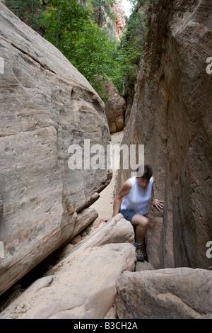 hiker in Hidden Canyon, Zion National Park, Utah - Stock Photo