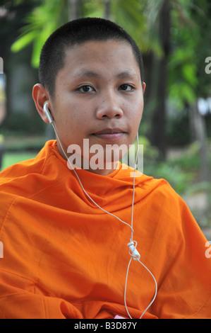Monk with headphones - Stock Photo