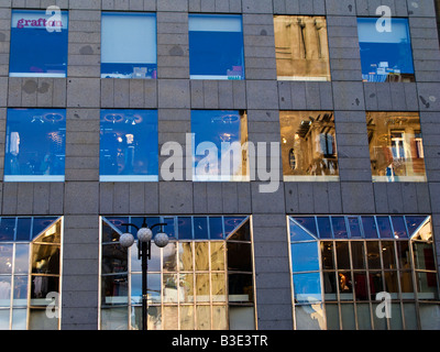 Reflection of Old Town buildings in the windows of modern office block, Prague Czech Republic - Stock Photo