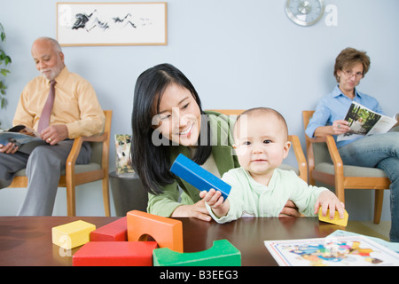 Patients waiting in a doctors office - Stock Photo