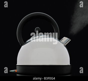 Boiling kettle Against a Black Background - Stock Photo