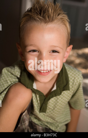 portrait of smiling four year old boy, closeup, toothy grin - Stock Photo