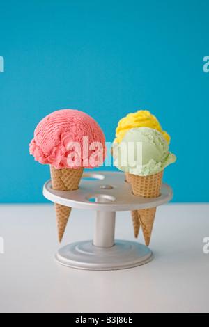 three ice cream cones pistachio, lemon and strawberry - Stock Photo